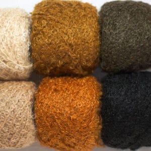 laine dolly mo bouclée permettant de réaliser des chevelures courtes ou longues et bouclées sur des poupées Waldorf