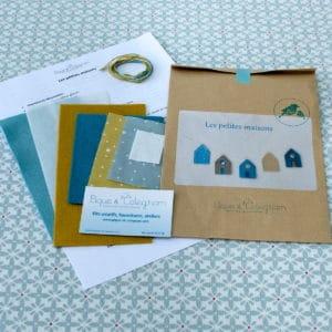 Les petites maisons, kit créatif permettant la réalisation d'une guirlande de petites maisons à l'esprit scandinave en tissu et feutrine