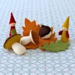 kit à coudre de petits trésors des bois comprenant 2 champignons, 2 feuilles, 1 chataigne et 2 lutins en feutrine de laine